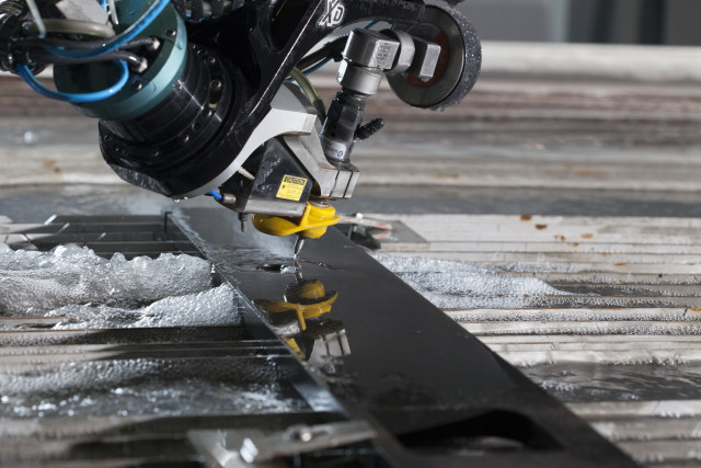 A Flow Mach 4c waterjet cutting carbon fiber. (Image courtesy of Flow International.)