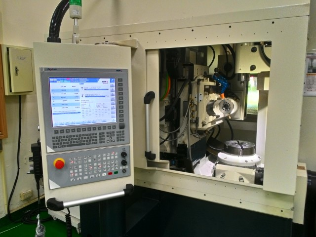 The gear hobbing machine uses a NUM FS152i operator panel, with a custom-developed HMI. (Image courtesy of NUM.)