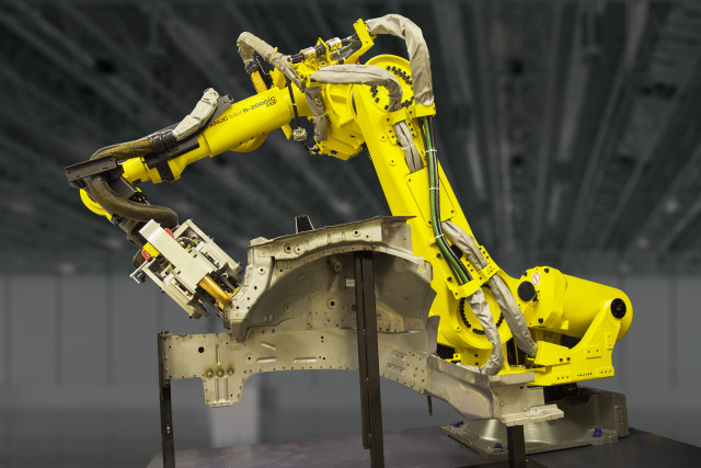 A popular choice for automotive manufacturers, FANUC's R-2000iC Robot spot welds an automotive panel. (Image courtesy FANUC America.)