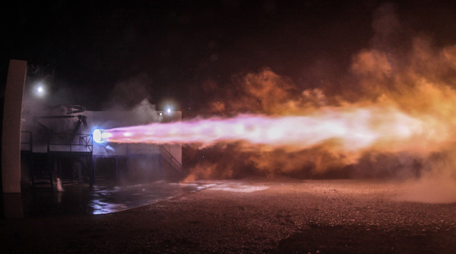 Test firing the Raptor engine. (Image courtesy of SpaceX.)