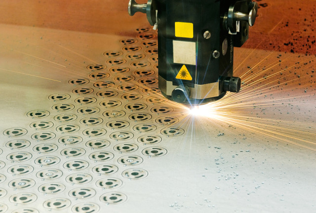 Laser cutting.