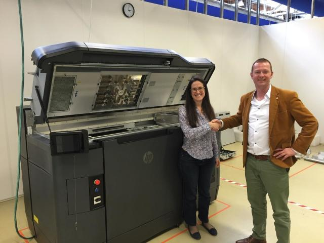 HP's Virginia Palacio and Shapeways' Vice President of Manufacturing Stefan Rink with the first production-ready HP jet fusion system at Shapeways' facility in the Netherlands. (Image courtesy of Shapeways.)