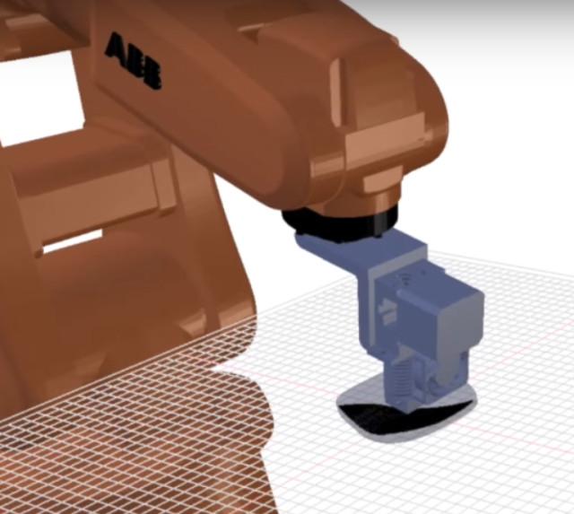 Arevo Labs 3D printer uses a robotic arm to make a carbonfiber part.
