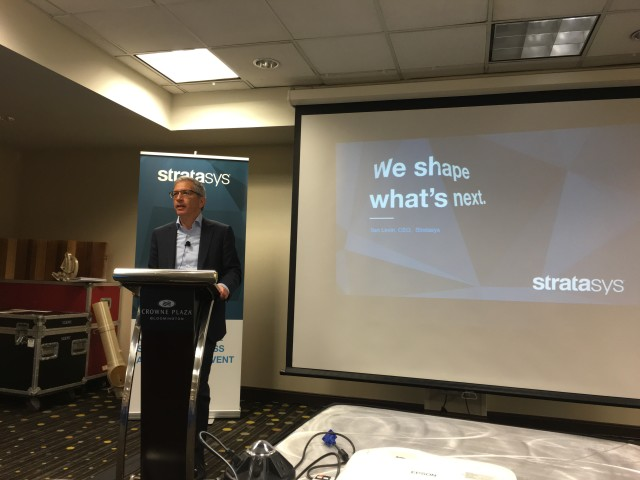Stratasys CEO Ilan Levin, les that 2 months on the job, hosts a press event to announce a size breakthrough in 3D part printing.
