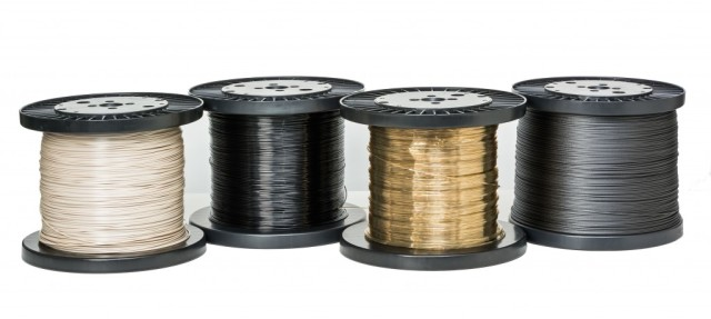 Four different filaments from Arevo Labs made from varying combinations of PEEK, PAEK and PARA polymers as well ascarbon fiber, glass fiber and carbon nanotubes. (Image courtesy of Arevo Labs.)