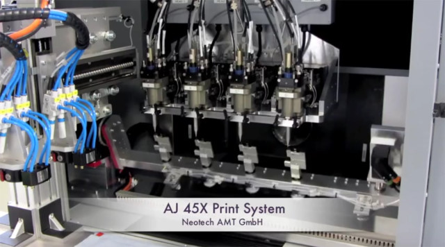 A quad setup of Marathon print modules allows for for batch production of 3D-printed electronics. (Image courtesy of Optomec/YouTube.)