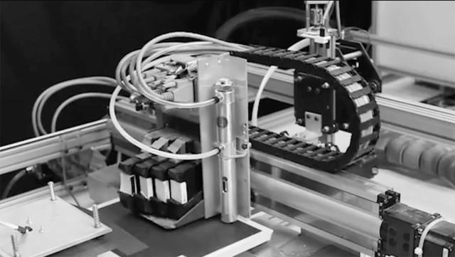 The CBAM inkjet head depositing the liquid solution. (Image courtesy of Impossible Objects.)