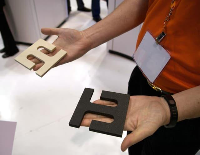 Two composite parts 3D printed with EnvisionTEC's new SLCOM platform.