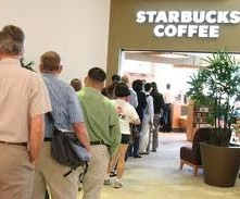 American workers wait in line at Starbucks