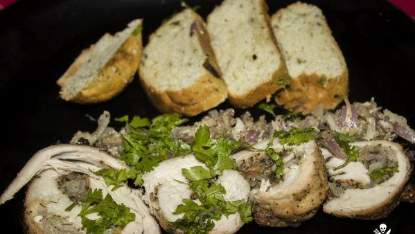 Healthy stuffed chicken breast with garlic bread