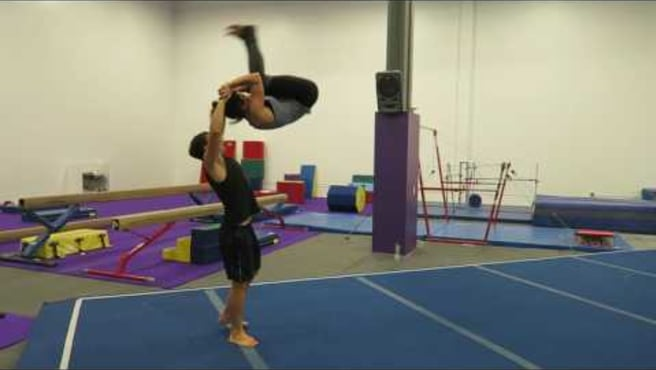 Two High Roll Out (standing acrobatics)