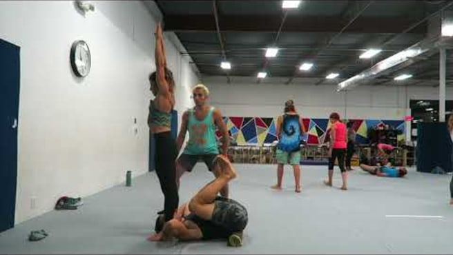 Standing back flip to front plank (Acroyoga)