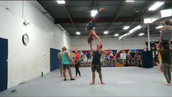 Cartwheel exit from one-handed standing hand-to-hand