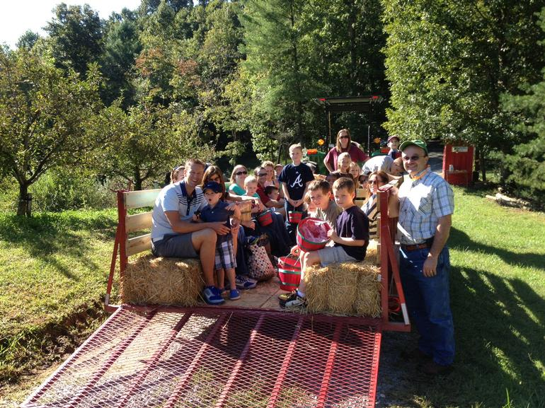 Red Apple Barn - Customers getting ready to unload the wagon and pick apples.