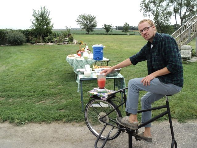 Good Roots Farm and Gardens - Michael making pedal powered melon smoothies for the Tour de Gardens