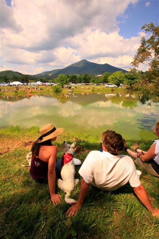 Peaks of Otter Winery & Orchards - Sitting by the pond that the muskrat race is held and overlooking the festival with the Blue Ridge mountains in the back ground.