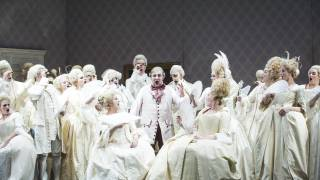 Don Pasquale, Glyndebourne Tour 2015. Glyndebourne Chorus and centre, Don Pasquale (José Fardilha). Photographer: Tristram Kenton