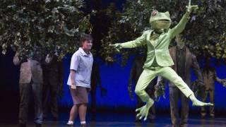 Glyndebourne Festival 2015, L'enfant et les sortilèges.  Child (Danielle de Niese) and Frog (François Piolino). Photographer: Richard Hubert Smith