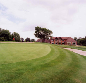 Beautiful rolling 18th green with the Henley golf clubhouse exterior in the background