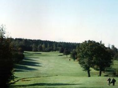 Tree-lined fairway on the 1st hole