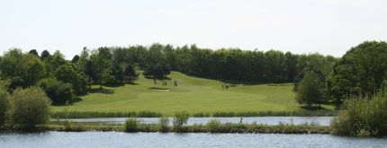 View up the fairway across the lake at China Fleet Golf Club