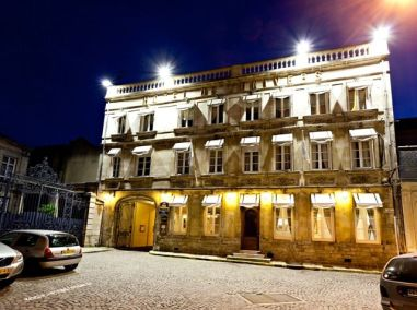 Exterior night image of Best Western Hotel de l'Univers