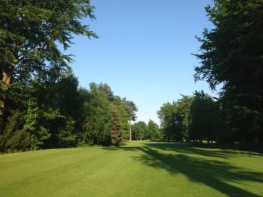 The narrow tree-lined 7th fairway