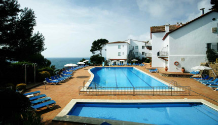 Stunning swimming pool and hotel exterior at Park Hotel San Jorge, Costa Bravam, Spain