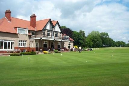 The clubhouse at Ormskirk, overlooking the putting green and course
