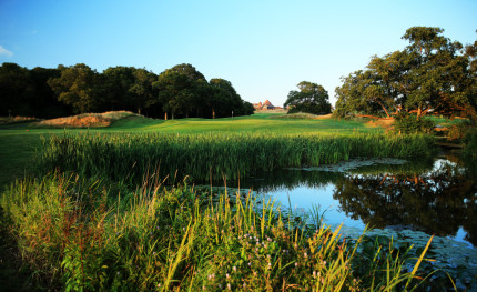 A picturesque view of the water hazard on 17th hole at East Sussex National, England