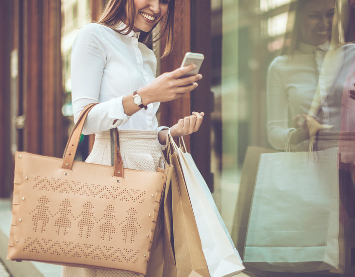 image of millennial woman using a mobile application to shop