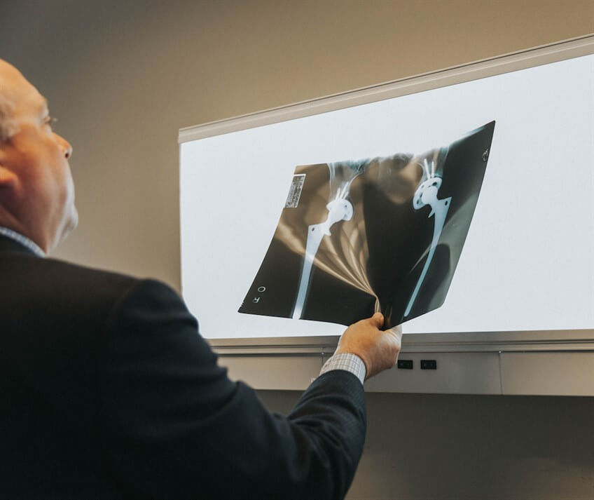 Doctor Nathan Gilbert looking at a patient x ray