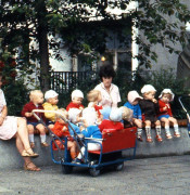 East_Berlin_childminders_with_children_and_strollers_seated_on_a_wall_1984.jpg