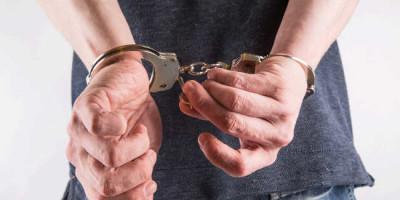 mens hands handcuffs 2 dc.jpg