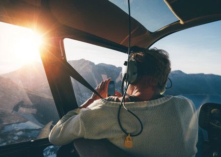 bigstock-Female-Tourist-On-Helicopter-T-120133109.jpg