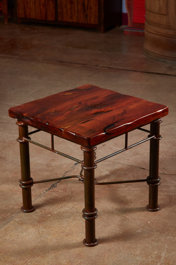 We make end tables of all shapes and sizes.  With drawers or without.  Round.  Square. This one happens to be made of mesquite and mounted on an iron base.   Handy fact about mesquite:  the longer you leave it in the sun, the redder it gets.