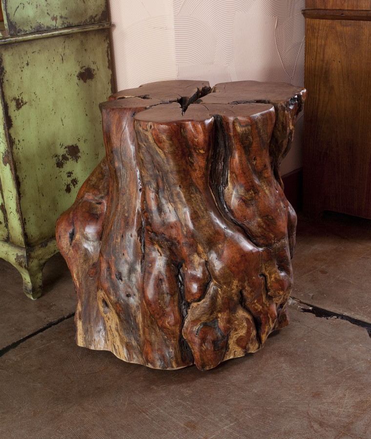This mesquite stump was carefully cut, sanded, and finished to form the base for a 6' round mesquite table top.