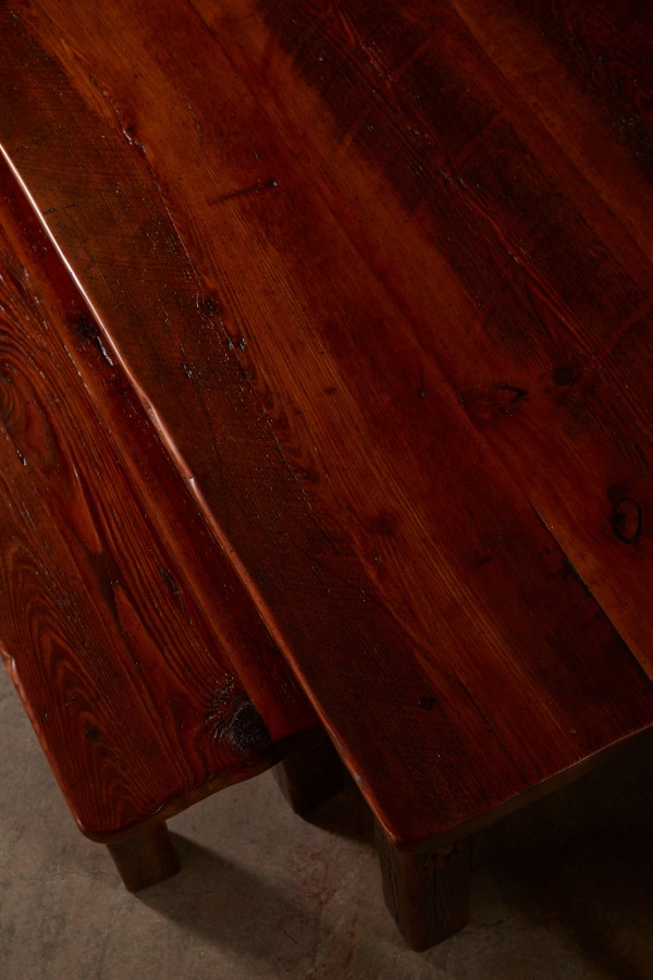 You can see the nail holes and saw cuts in this long-leaf pine dining table  and matching bench.  In addition to this character, the wood grain is absolutely stunning.