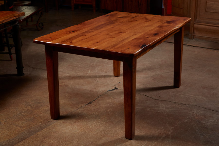 A lot of people are building cabinets out of knotty alder these days.  We can make you a table to match.