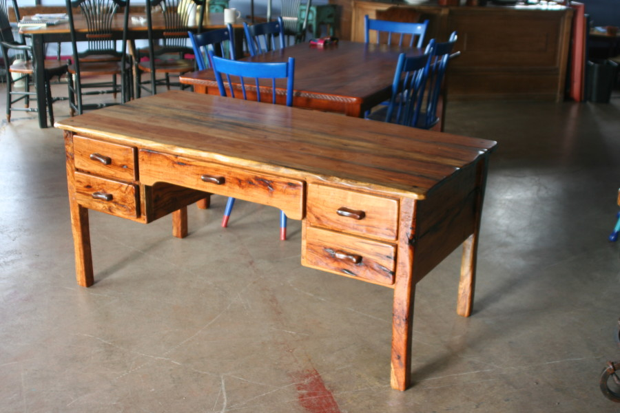 This 5' pecan is ideal for pretty much any activity requiring a desk.  With 5 drawers, it's got plenty of storage.  Carefully handcrafted, we can build you one any size you want.  We even make the handles.