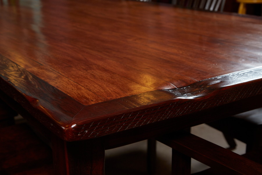 This detail shot shows the contrast between new hickory flooring inlaid in reclaim pine.  Note the old saw cuts on the edge of the table.  The long-leaf pine was pulled from an old house built in the 1920s.