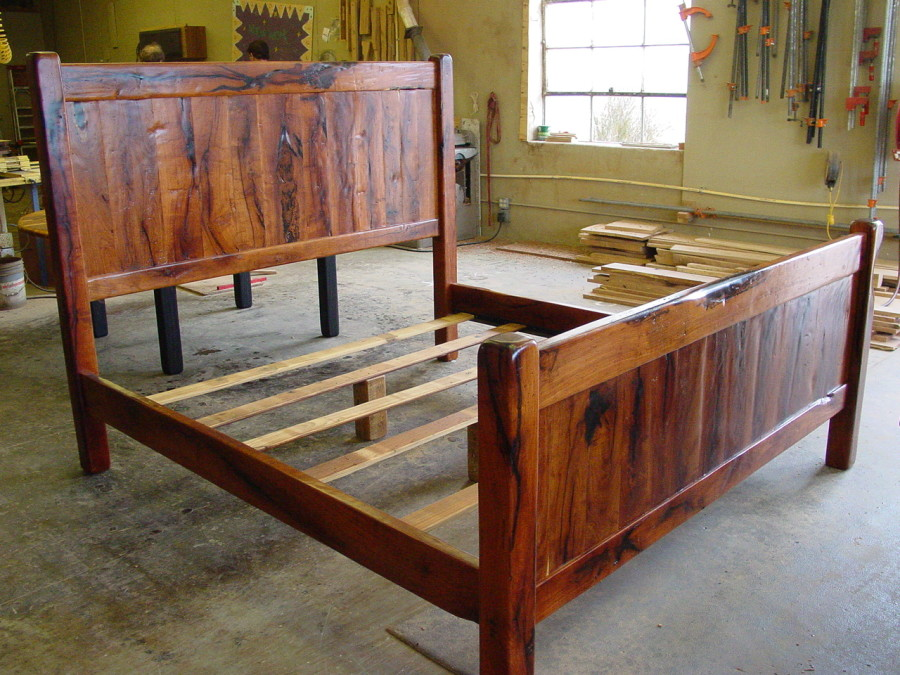 Of course we build beds.  You tell us what size you want and what kind of wood you want it made out of and we go from there.