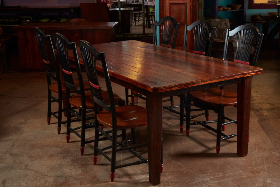 This table is made from old pine flooring that was torn out of a house built in the early 1900s.  The tongue and groove flooring makes an excellent table top and allows you to see the scars from its previous life.