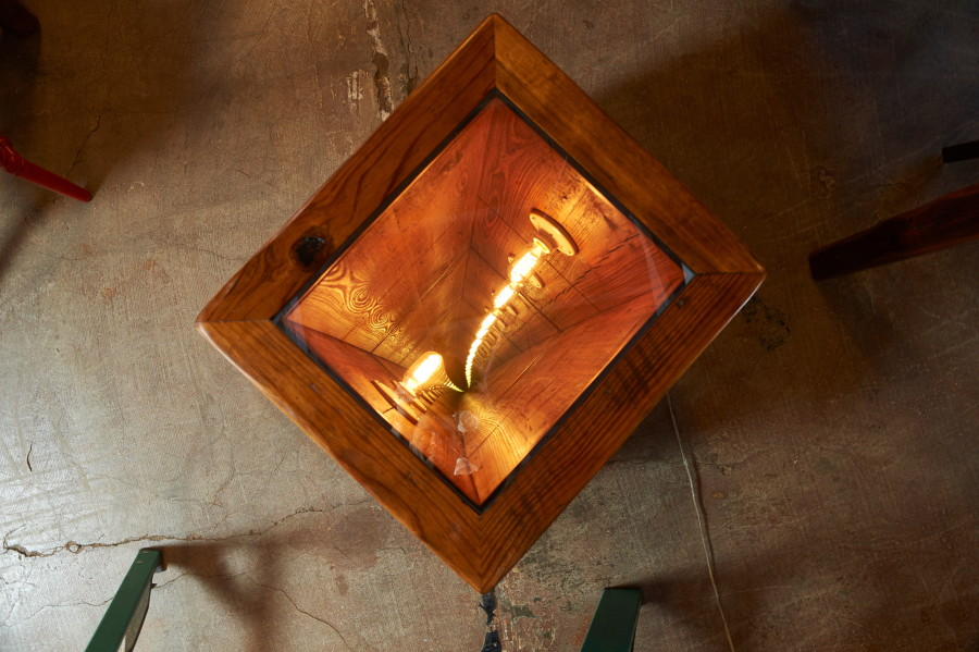 This end table is made from reclaimed long-leaf pine, a couple of mirrors, and some antique light bulbs.  You can literally stare into it forever.
