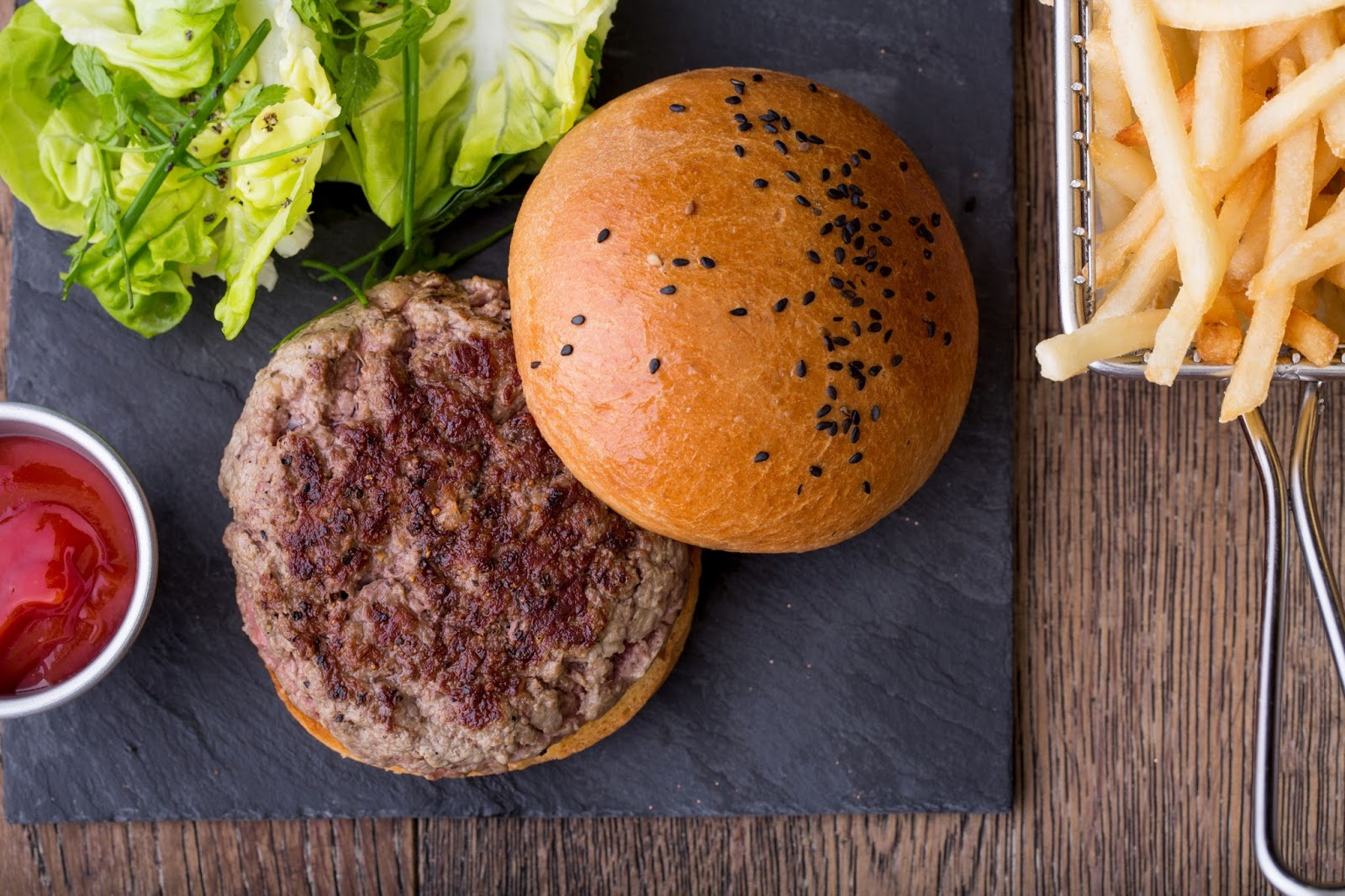Escargot, beef patty, beef burger, burger, fries, burger and fries, sesame bun