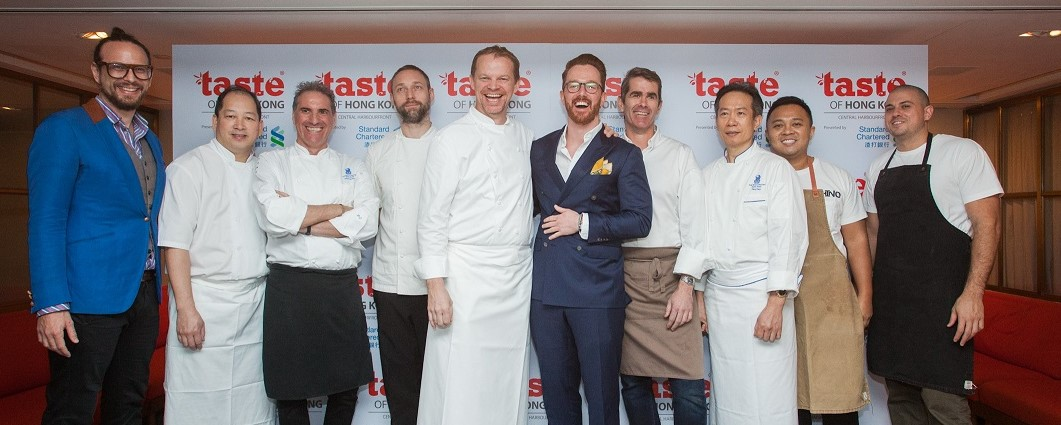 Simon Wilson (centre in blue), Event Director of IMG Culinary Asia with chefs representing Hong Kong's hottest restaurants at the launch, (from left to right); Serge et le phoque, Duddell's, Tosca, Aberdeen Street Social, Amber, Arcane, Tin Lung Heen, CHINO, Yardbird and RŌNIN