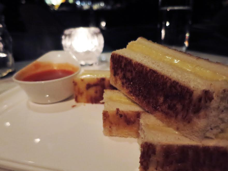 grilled gruyere cheese sandwich paired with tomato soup