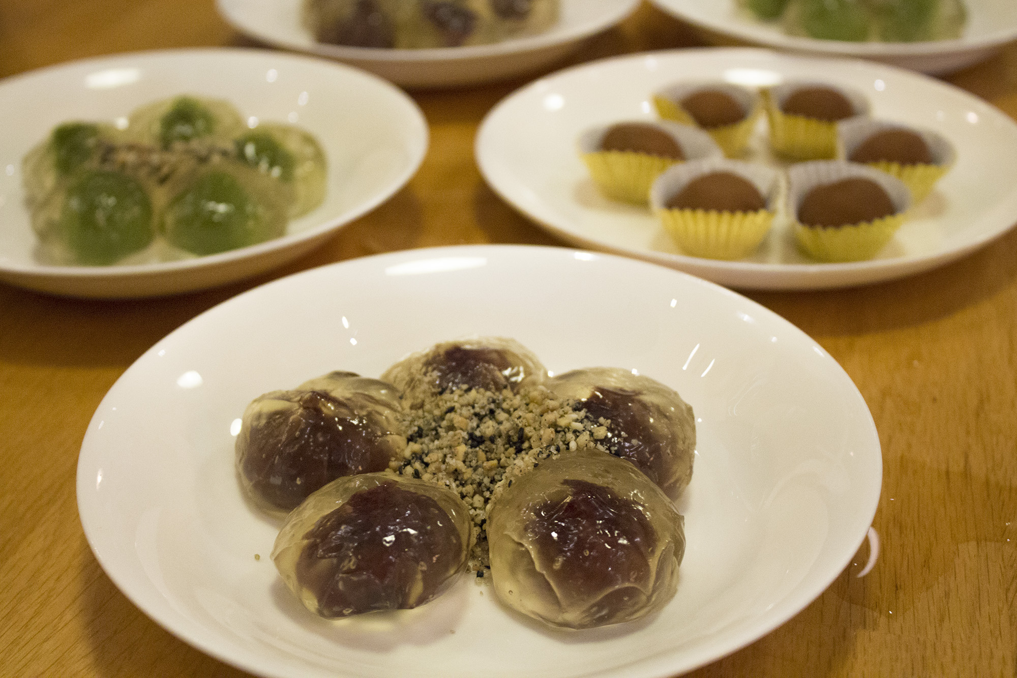 Red bean paste sweet ball with crushed peanuts and sesame