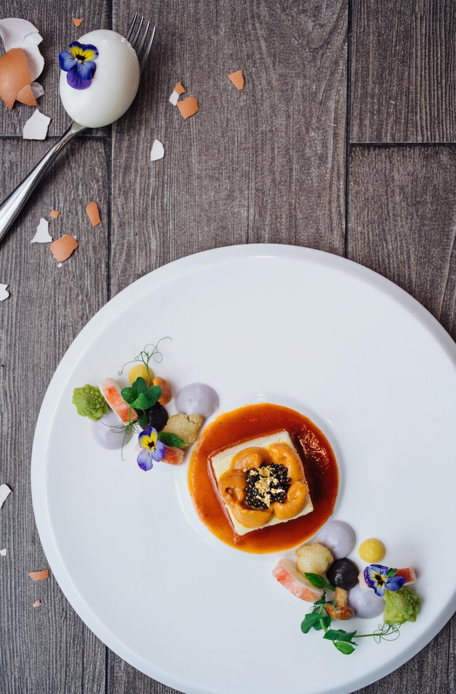 Image: Steamed Marans Egg / Hokkaido Sea Urchin / Iranian Ossetra caviar / Alaska Crab Leg/  Crustacean essence