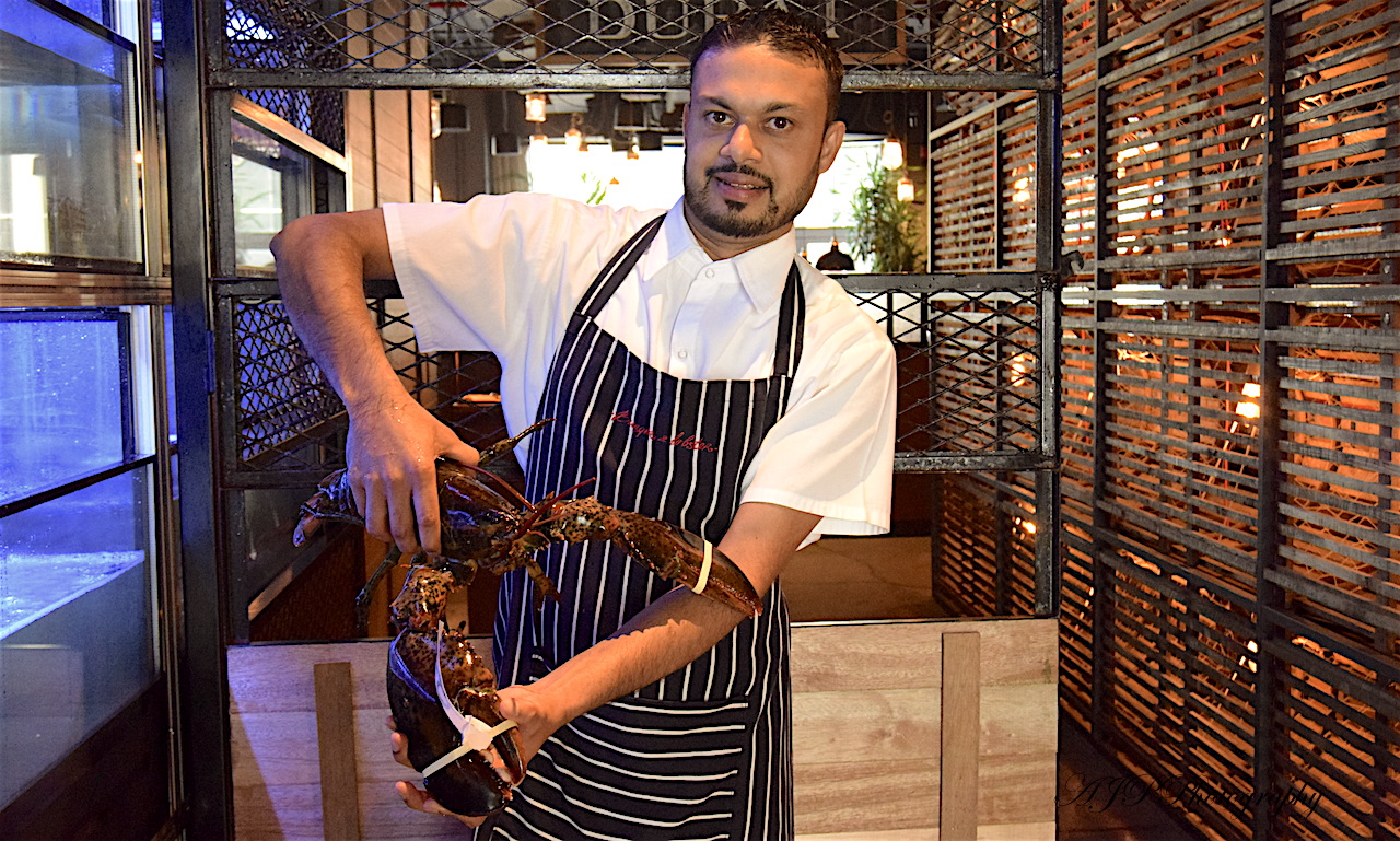Chamandas(our server) and their live Lobster from the tank